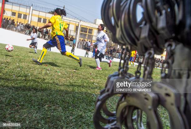 TOPSHOT Inmates from different Peruvian prisons play during their First Interprison World Cup Russia 2018 tournament football match at the Lurigancho...