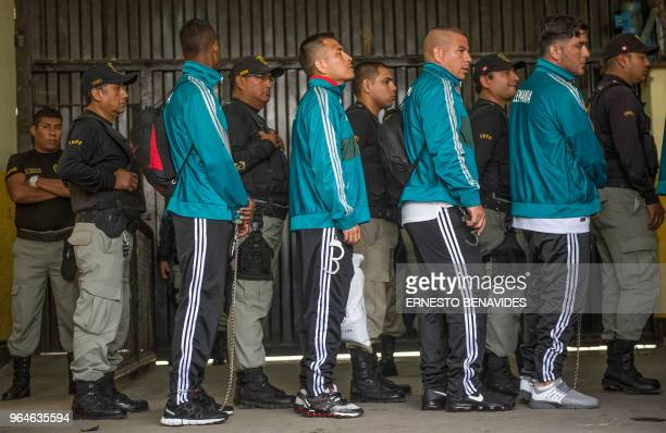 Inmates from Peruvian jails are escorted by guards prior to their First Interprison World Cup Russia 2018 tournament football match at the Lurigancho...