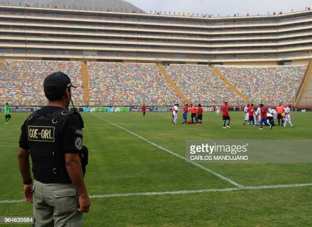 Inmates from Peruvian prisons of Lurigancho and Chimbote are pictured as they play under heavy guard the final match of the First Interprison World...