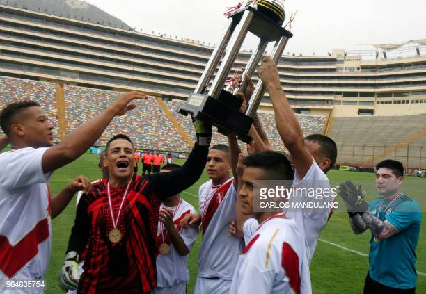 Inmates from Peruvian prisons of Lurigancho celebrate after winning the First Interprison World Cup Russia 2018 tournament final match against...