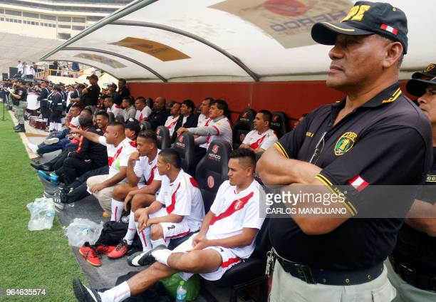 Inmates from the Peruvian prison of Lurigancho are pictured on the bench under heavy guard during their First Interprison World Cup Russia 2018...