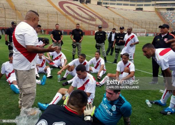 Inmates from the Peruvian prison of Lurigancho take a break under heavy guard during their First Interprison World Cup Russia 2018 tournament final...