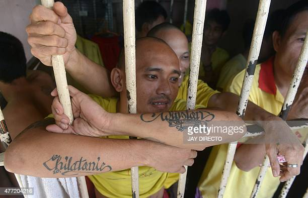 Inmates from the Quezon City jail wait to be processed during a mass screening for Tuberculosis in suburban Manila on June 15 2015 The International...