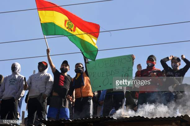 Inmates from the San Sebastian prison in Cochabamba, Bolivia, shout slogans during a riot demanding for biosecurity measures following the death of...