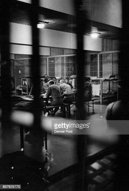 Inmates gather around table for quiet talk in dormitory of the Denver County Jail Seven prisoners sawed bars and escaped Thursday night but all were...