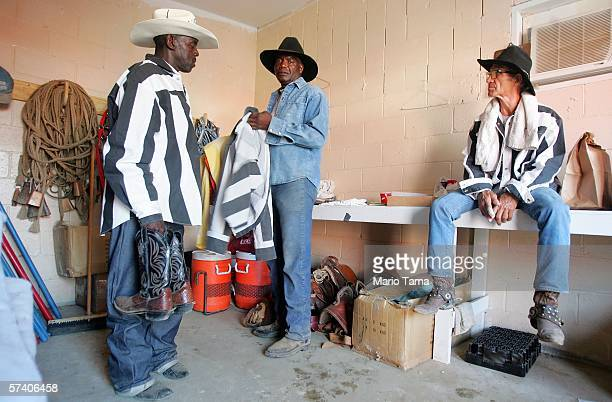 Inmates gather their equipment at the finish of the Angola Prison Rodeo at the Louisiana State Penitentiary April 23 2006 in Angola Louisiana The...