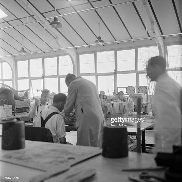 Inmates in a basketweaving workshop at Broadmoor Hospital a highsecurity psychiatric facility in Berkshire 1956 Original publication Picture Post...