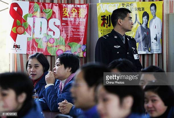 Inmates in Chongqing Women Correctional Center attend a campaign to fight AIDS on December 1 2004 in Chongqing China China says an estimated 840000...