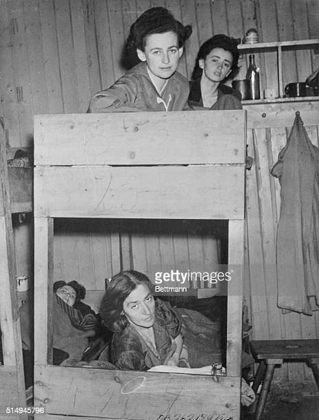 Inmates in the Typhus Hospital at Belsen Concentration Camp, which was being cleaned up as more beds were being made available is shown.