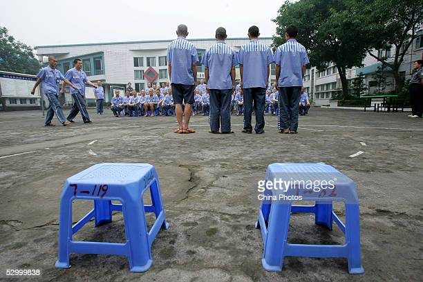 Inmates learn to walk like military soldiers during a behavior training session at Chongqing Prison on May 30 2005 in Chongqing Municipality China...