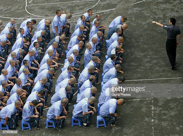Inmates listen to a police officer during a behavior training session at Chongqing Prison on May 30 2005 in Chongqing Municipality China According to...