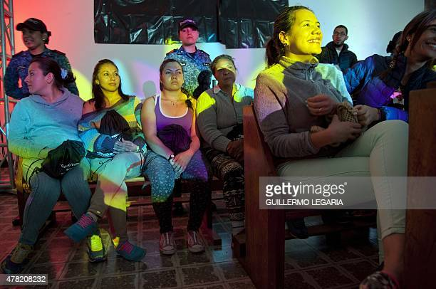 Inmates of 'El Buen Pastor' women's prison attend a TEDx motivational talk on June 23 2015 in Bogota Colombia AFP PHOTO/Guillermo LEGARIA