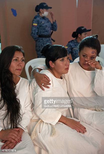 Inmates of 'El Buen Pastor' women's prison cry as they attend a TEDx motivational talk on June 23 2015 in Bogota Colombia AFP PHOTO/Guillermo LEGARIA