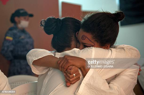 Inmates of 'El Buen Pastor' women's prison embrace as they attend a TEDx motivational talk on June 23 2015 in Bogota Colombia AFP PHOTO/Guillermo...