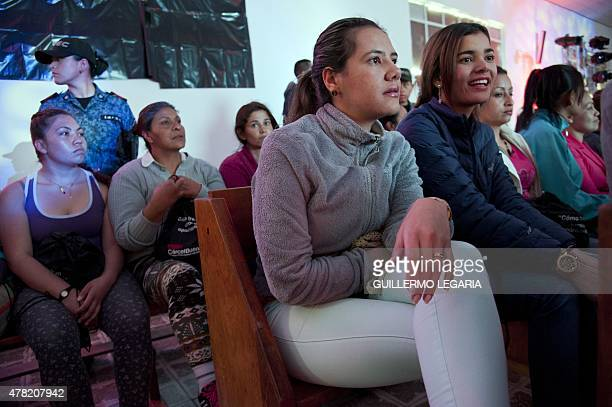 Inmates of 'El Buen Pastor' women's prison listen to a TEDx motivational talk on June 23 2015 in Bogota Colombia AFP PHOTO/Guillermo LEGARIA