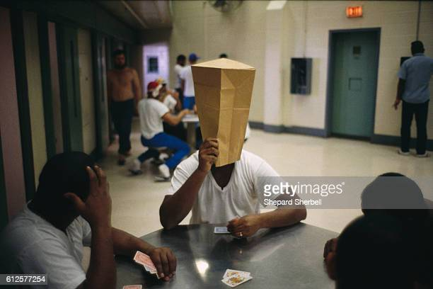 Inmates play card games in the parole violation wing of Buckingham Correctional Institution the maximum security prison in Buckingham County Virginia