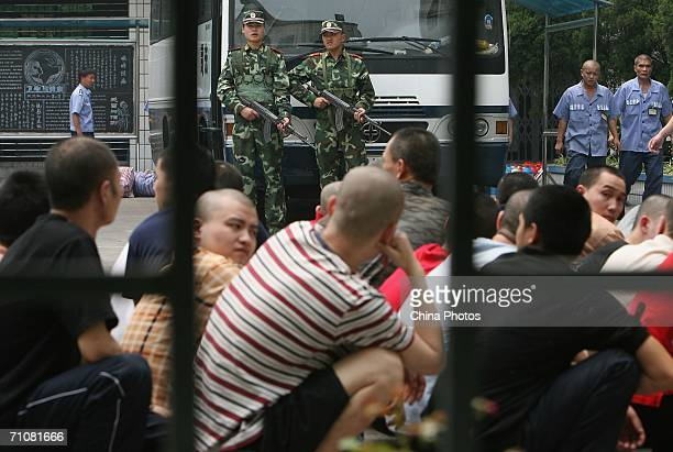 Inmates prepare to get on a coach during a prisoner transfer operation on May 30 2006 in Chongqing Municipality China The mass prisoner transfer is...