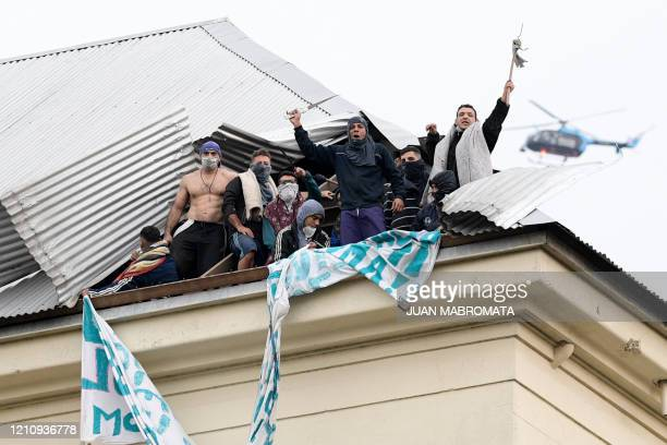 Inmates protest on the roof of Villa Devoto prison demanding measures to prevent the spread of the Covid19 coronavirus after a case was reported...