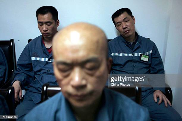 Inmates receive a psychological correctional treatment during a psychological training and consultation session at Qingpu Prison on April 8 2005 in...
