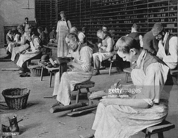 Inmates repairing shoes in a cobbling workshop at the Royal Earlswood Hospital in Redhill Surrey circa 1890 The hospital was the first instuitution...