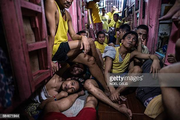 Inmates rest in their sleeping quarters inside the Quezon City jail at night in Manila in this picture taken on July 18 2016 There are 3800 inmates...