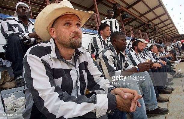 Inmates sit together as they prepare for the start of the Angola Prison Rodeo at the Louisiana State Penitentiary April 23 2006 in Angola Louisiana...