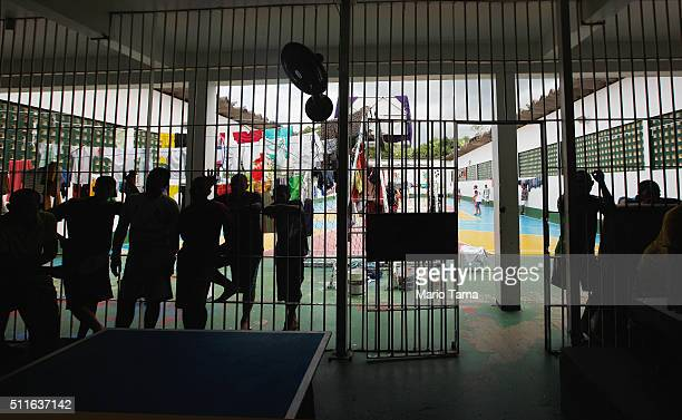 Inmates stand in the Anisio Jobim penitentiary complex on February 17 2016 in Manaus Brazil The men's section of the prison holds over 1200 inmates...
