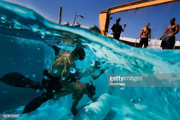 Inmates training to become commercial underwater divers compete in a 'pipe roll' team building exercise against other inmates at the Marine...