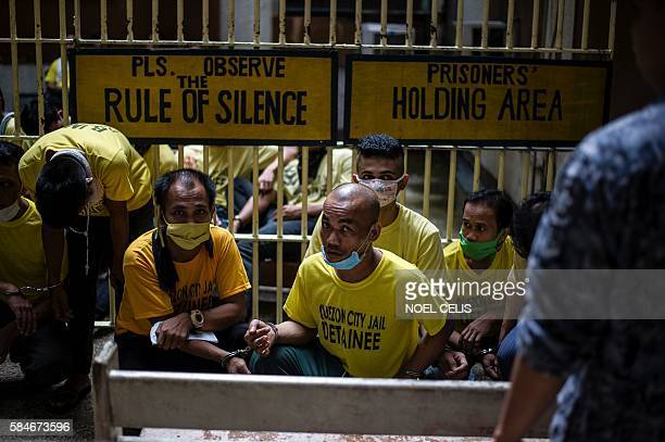 Inmates wait at the holding area to attend their trial at the Quezon City regional trial court in Manila in this picture taken on July 29 2016 There...