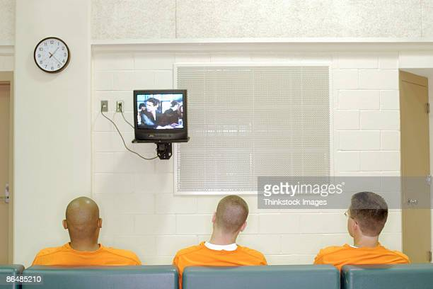 inmates watching television - prisoner stock pictures, royalty-free photos & images