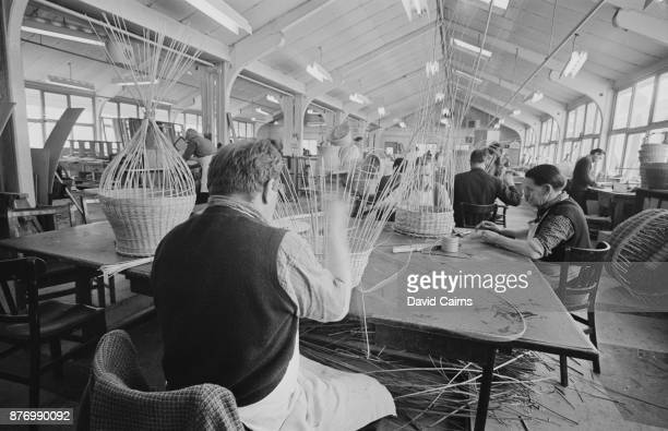 Inmates weave baskets at high-security psychiatric hospital Broadmoor Hospital, Crowthorne, Berkshire, UK, 27th March 1968.