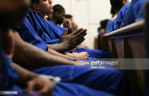 Inmates worship during Christmas Mass led by Archbishop Jose H. Gomez in a chapel at Men's Central Jail on December 25, 2019 in Los Angeles,...