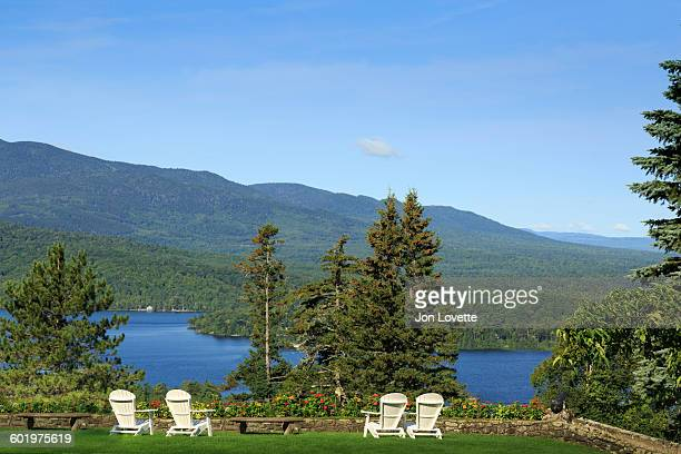 inn and gardens overlooking lake - moosehead lake stock photos and pictures