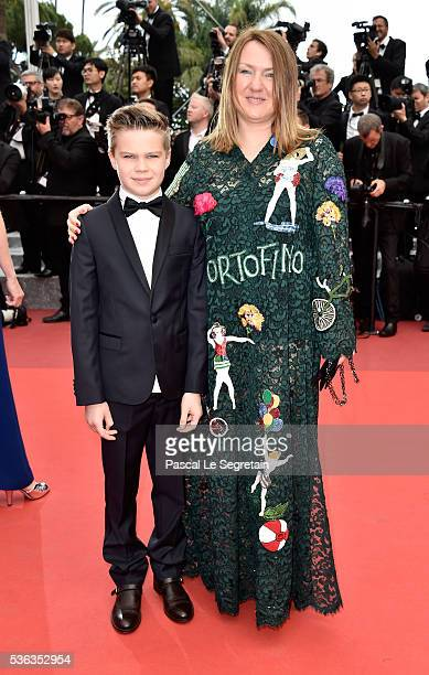 Inna Bazhenova with her son attend the closing ceremony of the 69th annual Cannes Film Festival at the Palais des Festivals on May 22, 2016 in...