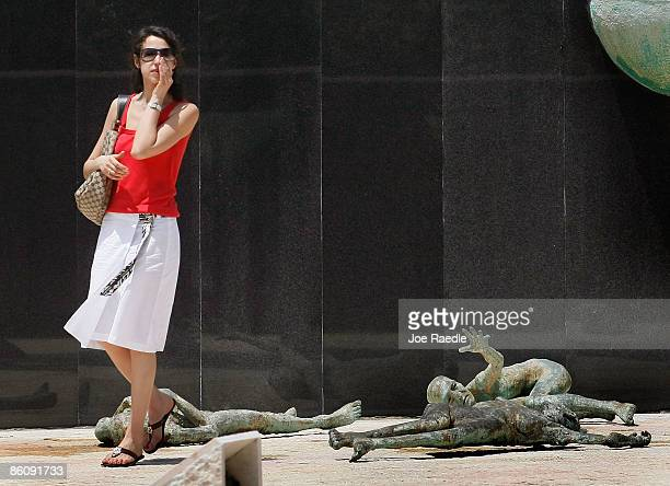 Inna Belogerkovskaya wipes away tears after becoming overcome with emotion as she visits the Holocaust Memorial during Yom HaShoahHolocaust...