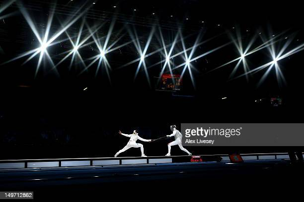 Inna Deriglazova of Russia and Arianna Errigo of Italy compete during the Women's Foil Team Fencing gold medal match against Russia on Day 6 of the...