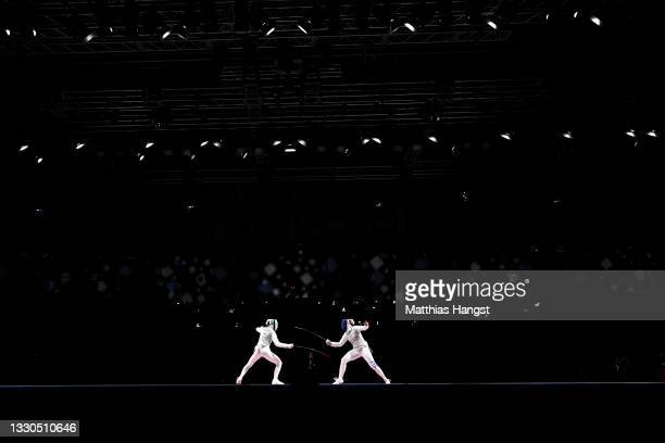 Inna Deriglazova of Team ROC competes against Alice Volpi of Team Italy in the Women's Foil Individual Fencing semifinal 1 on day two of the Tokyo...