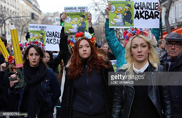 Inna Shevchenko leader of the women's rights organization Femen and activists hold Charlie Hebdo frontpages during a Unity rally Marche Republicaine...