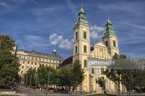 inner city parish church in budapest on a sunny autumn day. - emreturanphoto stock pictures, royalty-free photos & images