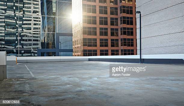 inner city parking lot - roof stock pictures, royalty-free photos & images