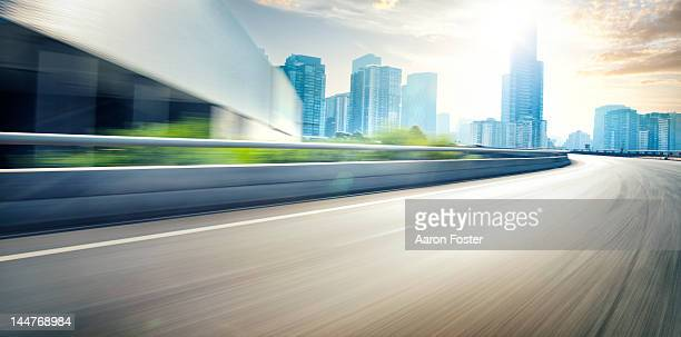 inner city road at sunset - motor racing track stock pictures, royalty-free photos & images