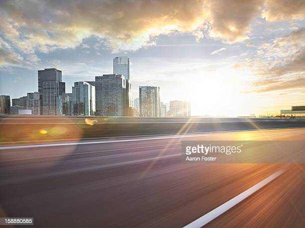 inner city road in motion - urban road stock pictures, royalty-free photos & images