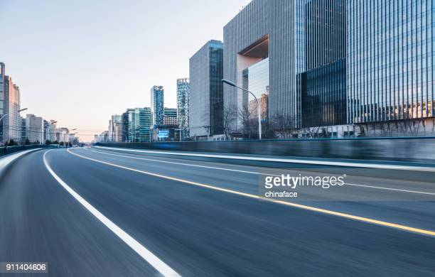 inner city road - thoroughfare stock photos and pictures
