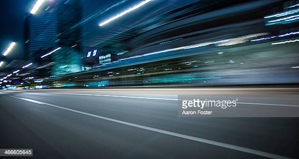 inner city street at night - urban road stock pictures, royalty-free photos & images