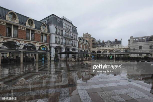 inner courtyard of piazza batumi on a rainy day. - emreturanphoto stock pictures, royalty-free photos & images
