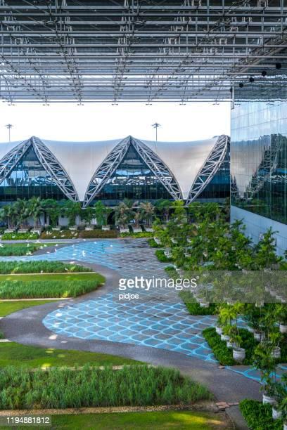 inner courtyard of suvarnabhumi airport bangkok thailand - suvarnabhumi airport stock pictures, royalty-free photos & images