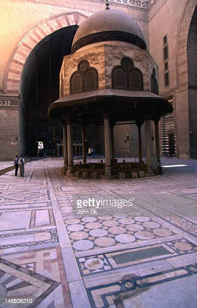 inner courtyard with fountain of sultan hassan mosque (1356-63). - sultan hassan mosque stock pictures, royalty-free photos & images
