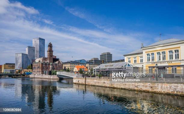 inner harbour canal malmö, with view of malmö börshus conference center, torhuset, the old harbour master's building and the highrise towers of the malmö live complex, malmö, scania, sweden, july 25, 2016 - malmo stock pictures, royalty-free photos & images