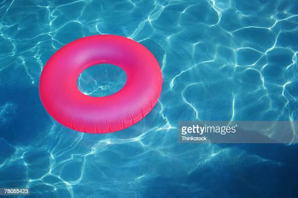 Inner tube floating in pool