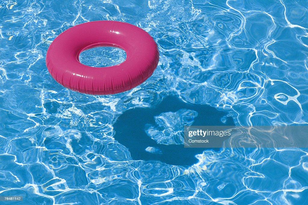 Inner tube in pool : Stock Photo